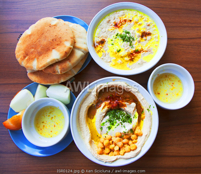 Israel, Tel Aviv. Hummus as served at the famed Abu Hassan also known as Ali Caravan mainly done from boiled chickpeas a traditional Levantine or Arabic plate which has become a staple in Jewish tradition also due to its kosher attributes.