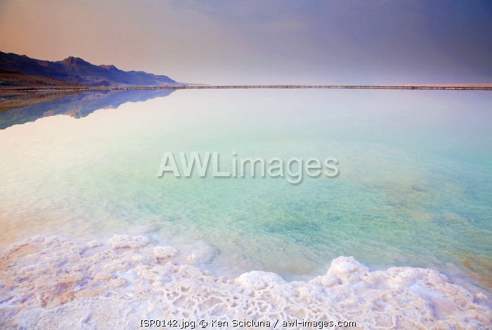 Israel, Dead Sea. The Southern part of the dead sea around Ein Bokek with salt formations on the shore and colours due to its mineral and salt formations.