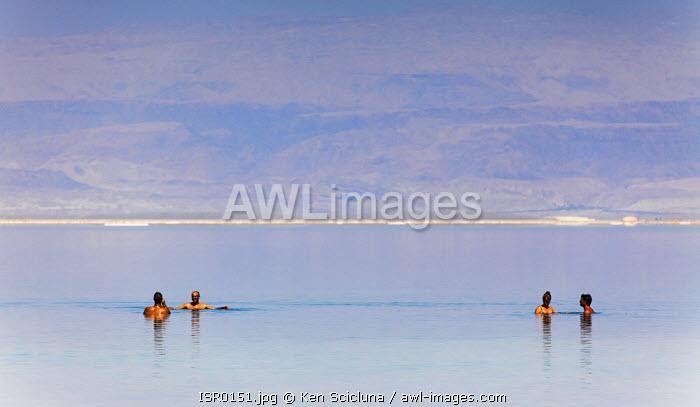 Israel, Dead Sea, Ein Bokek. People swimming in the dead sea.