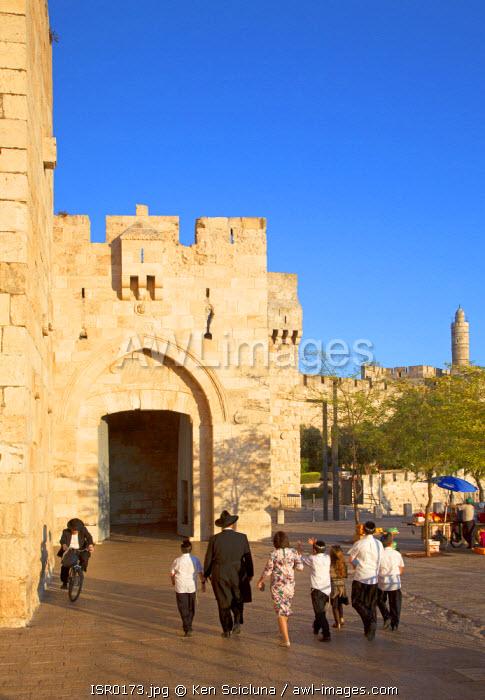 Israel, Jerusalem. Jews about the enter Old Jeruslaem through Jaffa Gate to celebrate Shabbat. Unesco.