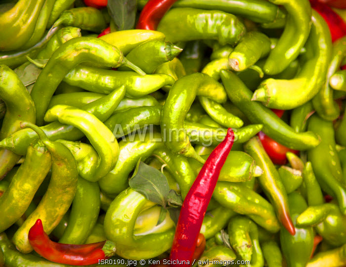 Israel, Jerusalem. Hot green and red chillies at a stall in the Mahane Yehuda Market.