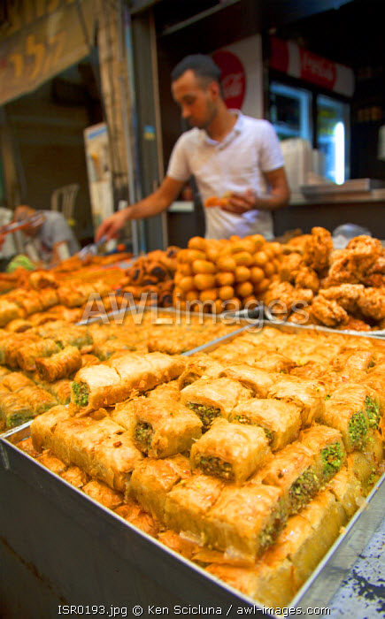 Israel, Jerusalem. A stall selling baklava amongst other delicacies which the Israelis have adopted from Turks at the Mahane Yehuda Market.