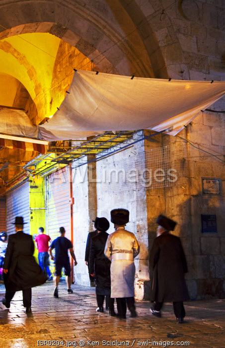 Israel, Jerusalem. Orthodox Jews walking out of the Damascus Gate after visiting the Western Wall during Shabbat. Unesco.