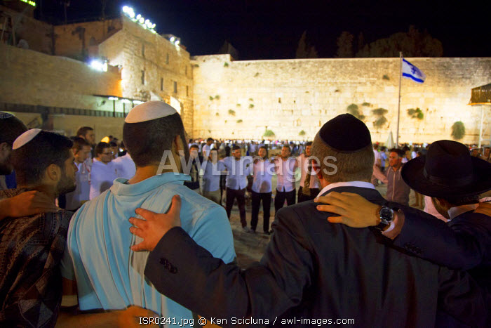 Israel, Jerusalem. Jews of different denominations dancing and singing together at the Western Wall during the Tisha B'Av final day or 9 Av which is the most intense with Jews sleeping the night out under the stars near the wall. Unesco.