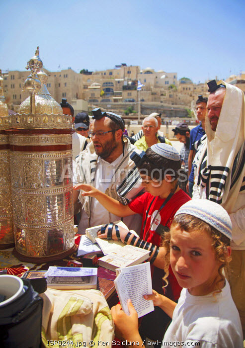 Israel, Jerusalem. Jews marking and reading the Torah at the Western Wall for the destruction of the Holy Temple and launch into exile during the Tisha B'Av final day or 9 Av which is the most intense with Jews sleeping the night out under the stars near the wall. Unesco.