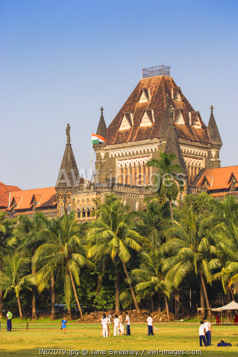 India, Maharashtra, Mumbai, Fort area, Children playing cricket in the Oval Maiden, with Bombay High Court behind