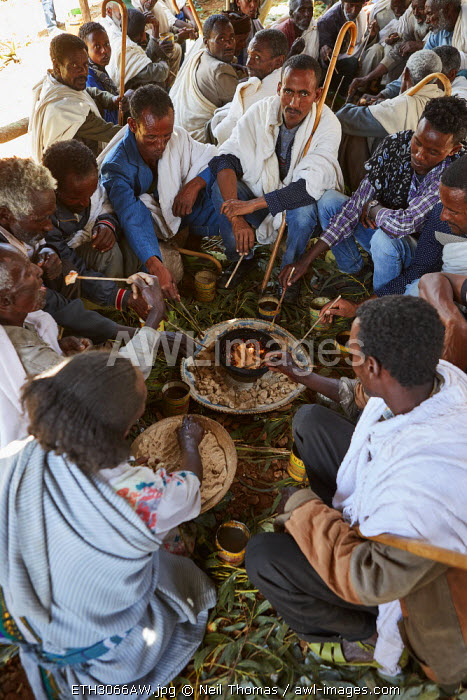 Tigrean people at a funeral party sharing a meal provided by the deceased family, Ethiopia, Africa