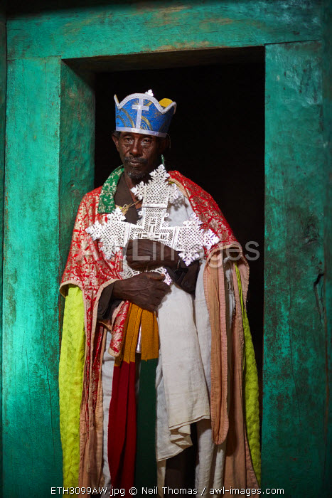 Priest holding the sacred cross of the church, Ethiopia, Africa