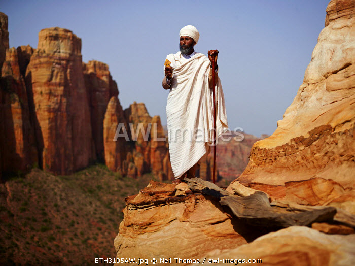 Priest looks out from the Abuna Yamata church, Ethiopia, Africa