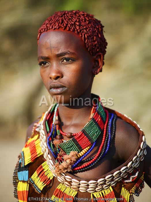 Hamer girl looks thoughtfully into the distance, Ethiopia, Africa