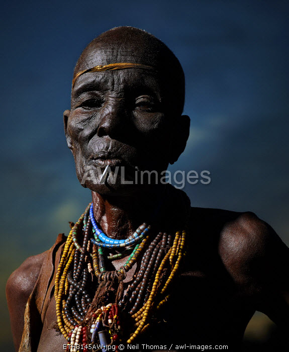 Old woman portrait at sunset, Ethiopia, Africa