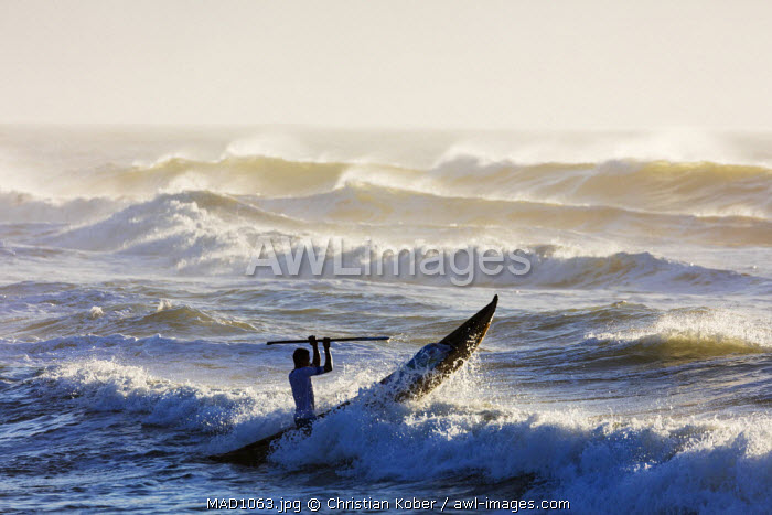 Africa, (easthern) Madagascar, Tamatave, Indian Ocean coast, fishermen with pirogue canoe going out to sea