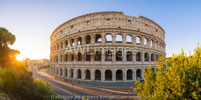Rome, Lazio, Italy. High angle panoramic view over the Colosseum square at sunrise.