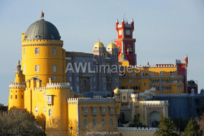 Portugal, Sintra. The Pena Palace, or Palacio da Pena, stands atop the Sintra Mountains near Lisbon.