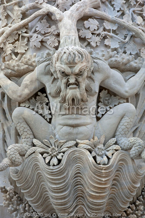 Portugal, Sintra.  A sculpture depicting Triton, the mythological Greek god and messenger of the sea, graces the facade of the Pena Palace, or Palacio da Pena, in the Sintra Mountains near Lisbon.