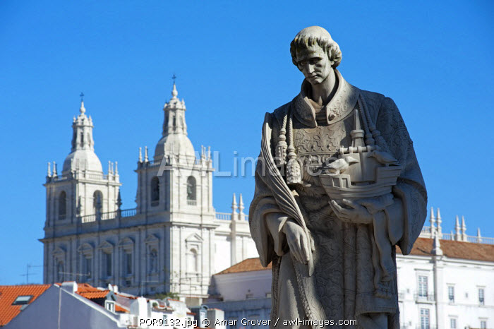 Portugal, Lisbon. Backed by the Church of S�o Vicente de Fora, a statue of Lisbon's patron saint - Saint Vincent of Saragossa, or Saint Vincent of Fora, in the Alfama district.