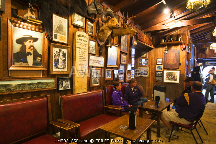 awl-images.com - USA / United States, South Dakota, Black Hills, Deadwood, main street, the saloon No.10 where Wild Bill Hickok (black jacket) was murdered by Jack McCall (coat) in 1876, a reconstruction takes place every day