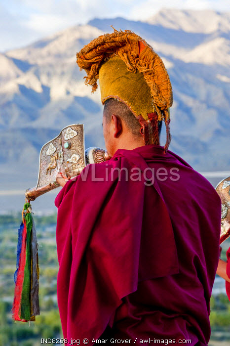India, Jammu & Kashmir, Ladakh, Thiksey. Each morning after sunrise monks blow conch horns, or dung-dkar, from the rooftop of Thiksey Monastery.
