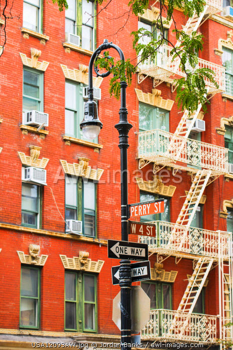 Street lamp and fire escapes in Greenwich village, New York, USA