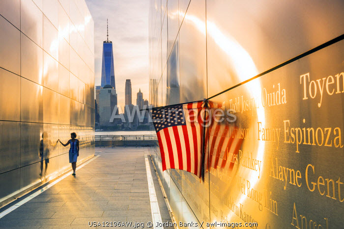 Woman walking through the Empty skies 9/11 memorial in Liberty state park, New York, USA