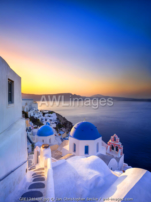 awl-images.com - Greece / Morning sunlight on the blue houses of Oia, Santorini, Greece