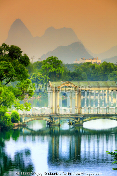 awl-images.com - China / China, Guangxi province, Guilin, old traditional bridge at dawn