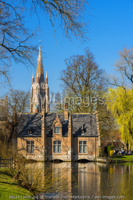 Picturesque view of the old town with belfry of Church of Our Lady in Bruges in the background, Bruges, West Flanders, Belgium
