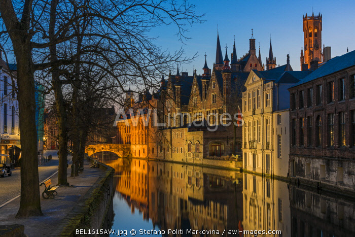 Picturesque blue hour view over Dijver canal with Belfort tower in the background, Bruges, West Flanders, Belgium