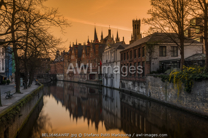 Picturesque sunset view over Dijver canal with Belfort tower in the background, Bruges, West Flanders, Belgium