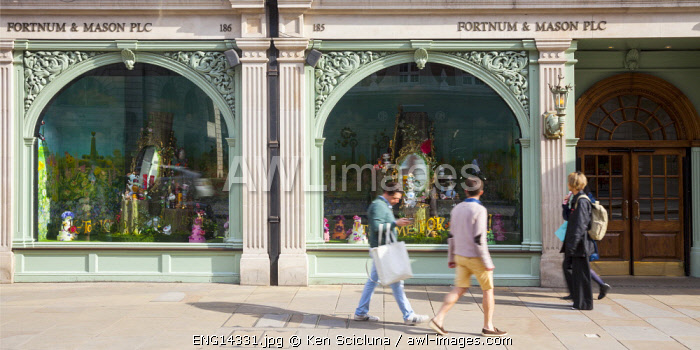 United Kingdom. England. London. People walking in front of Fortnum and Mason luxury shop.