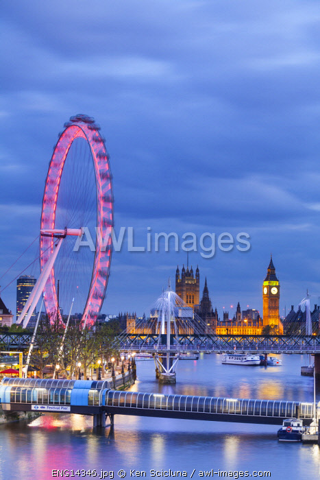 United Kingdom. England. London. The Millenium Wheel, The Big Ben and Parliament across the Thames River.