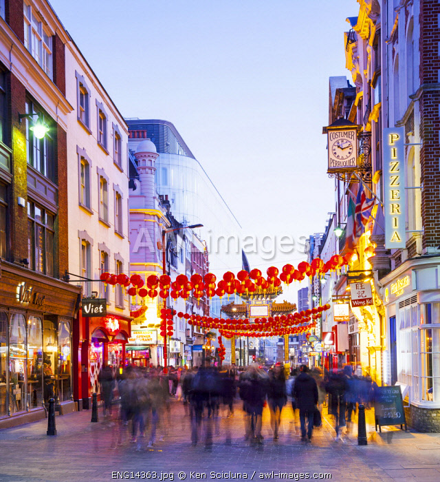 United Kingdom. England. London. People walking in Chinatown in the Soho Area.