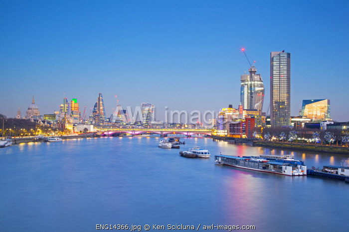 United Kingdom. England. London. Across the River Thames with St Paul s Cathedral the Oxo Building and Modern Architecture visible on the horizon.