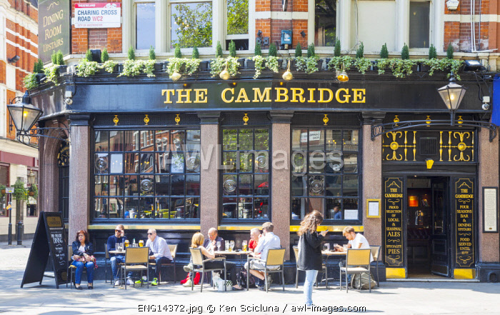 United Kingdom. England. London. People enjoying themselves at a pub al fresco.