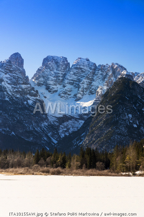 Winter view of frozen Lago di Landro or Durrensee lake with Cristallo mountain group in the foreground, Dolomites, Alto Adige - South Tyrol, Italy