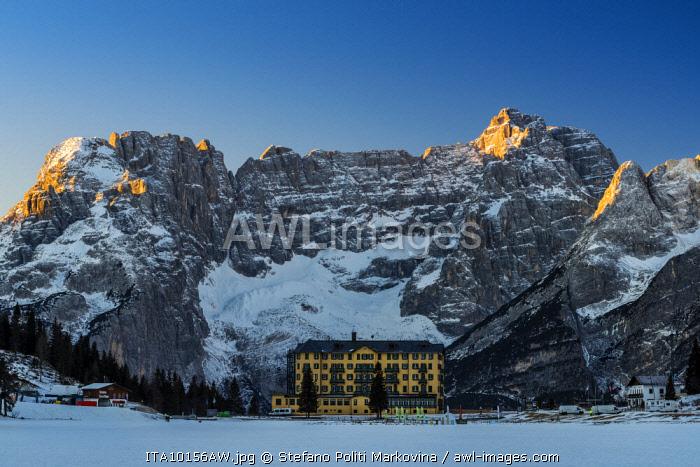 Winter view of frozen Lake Misurina with Sorapiss mountain group in the foreground, Dolomites, Veneto, Italy