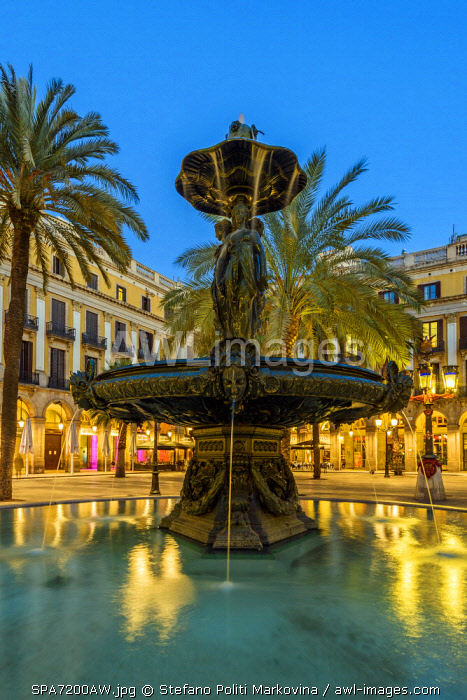 Evening view of the fountain in Plaza Real or Placa Reial, Barcelona, Catalonia, Spain