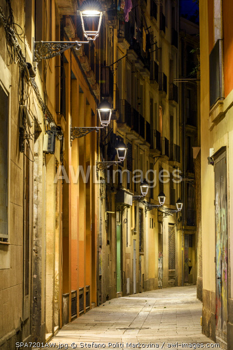 Night view of an empty street in the Gothic Quarter or Barrio Gotico, Barcelona, Catalonia, Spain