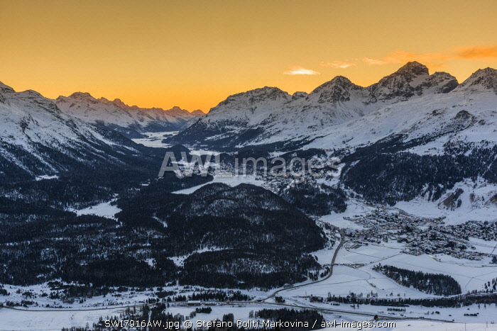 Scenic winter sunset view over Upper Engadine valley from Muottas Muragl with Celerina in the foreground and St. Moritz in the background, Graubunden, Switzerland