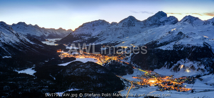 Panoramic winter view over Upper Engadine valley from Muottas Muragl with Celerina in the foreground and St. Moritz in the background, Graubunden, Switzerland