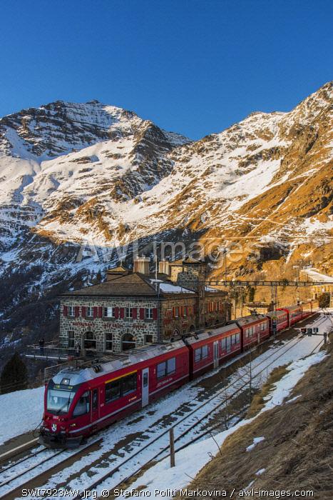 The famous Bernina Express red train at Alp Grum station, Graubunden, Switzerland