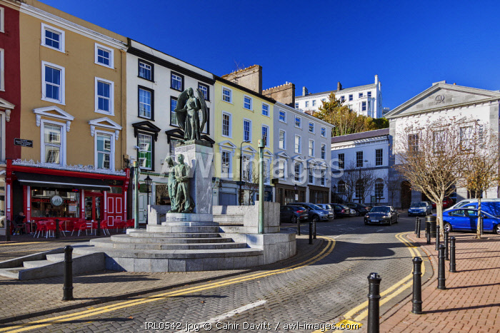 Colourful properties and the Lusitania Peace Memorial in Pearse Square, Cobh, Co. Cork, Munster,Ireland.