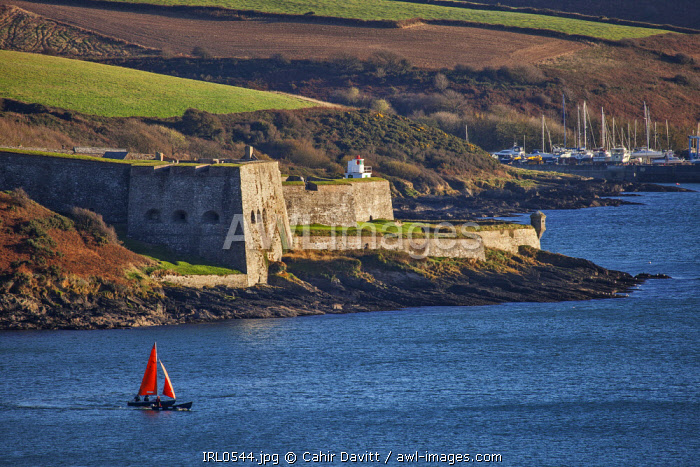 The seaward Devils Bastion and lighthouse of the 17th Century Charles Fort, with Kinsale boatyard in the background, Kinsale, Co. Cork, Munster,Ireland.