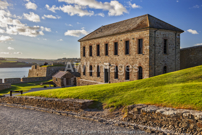 The Officers House / Barrack Stores and the seaward Devil's Bastions of the 17th Century Charles Fort, with Kinsale in the background, Kinsale, Co. Cork, Munster,Ireland.