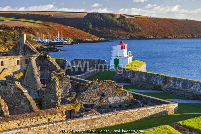 The Lighthouse (by Robert Reading), Soldiers' Quarters, Magazine and the seaward bastions of the 17th Century Charles Fort, looking toward the Celtic Sea, with Kinsale Boatyard in the background, Kinsale, Co. Cork, Munster, Ireland.