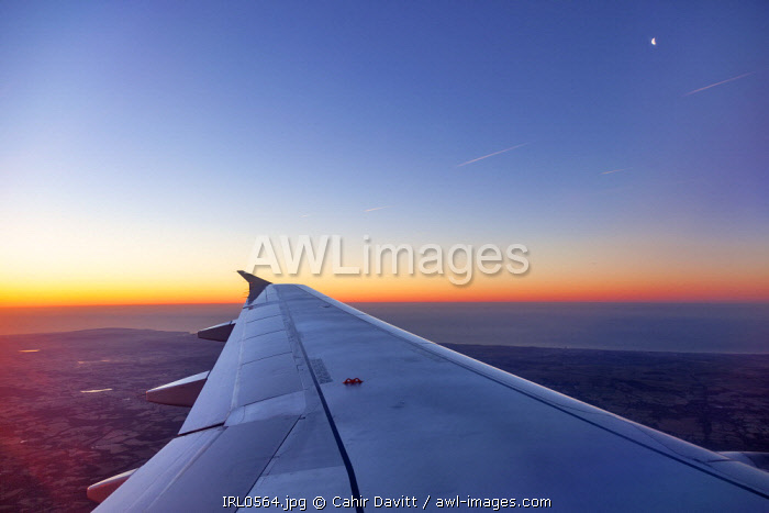 View from Aer Lingus Airbus A320 on departure from Dublin Airport overlooking Co Dublin and County Wicklow at dawn, WIcklow, Co. Wicklow, Ireland.