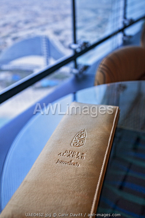 Leather bound menu in the bar and restaurant of the Al Muntaha Restaurant and Sky View Bar in the luxury 7 Star Burj Al Arab Hotel designed by the architects Atkins, Um Suqaim Second, Dubai, Dubayy, United Arab Emirates.