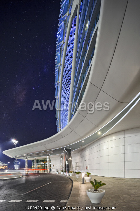 The fore court and entrance of the luxury 5 Star Yas Viceroy Hotel designed by the architects Asymptote Architecture, by night, Yas West, Abu Dhabi, United Arab Emirates.