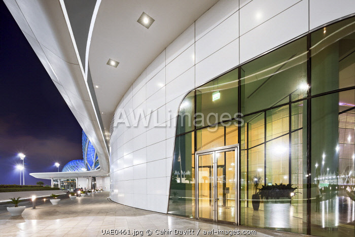 Setdown area and entrance to the business centre of the Yas Viceroy Abu Dhabi 5 Star Hotel designed by the architects Asymptote Architecture, at twilight, Yas Island, Abu Dhabi, United Arab Emirates.