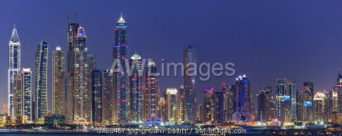 Panorama of the JBR Beach and Marina skyline at twilight, Dubai Marina, Dubai, United Arab Emirates.